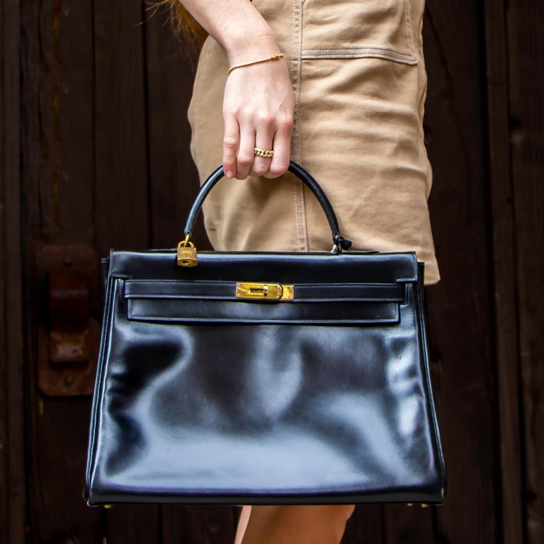 Beautiful large leather Hermes handbag. This bag has one large main pocket with three additional side pockets. This bag is made of smooth leather and has bronze-colored hardware. Made in France.  Height = 10 inches Width = 14 inches Depth = 5.5