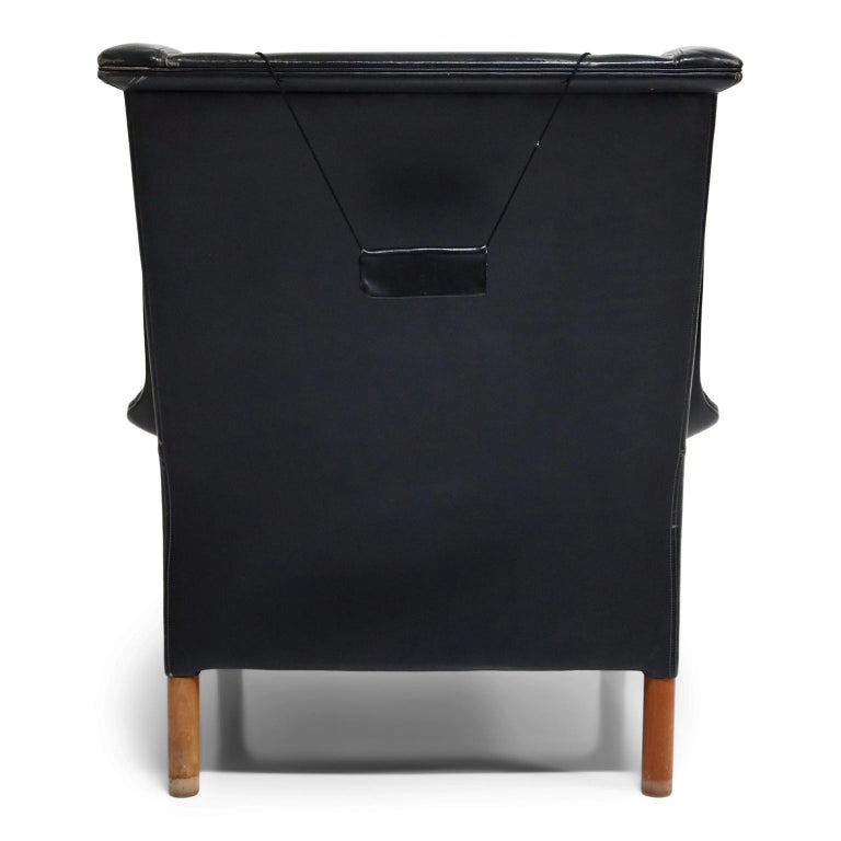 Danish Black Leather Wingback Armchair by Gerhard Berg for Stokke Fabrikker, circa 1965 For Sale