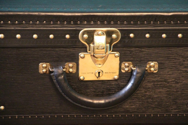 This top of the range all black leather Alzer 70 rigid suitcase features black leather trim, all solid brass LV stamped lock, clasps and studs. Large leather handle.
