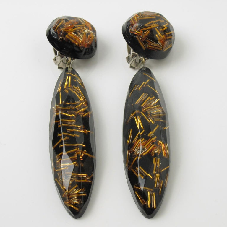 Modernist Black Lucite Drop Clip Earrings with Gilt Bead Inclusions For Sale