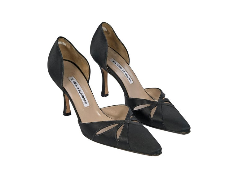 Product details:  Black satin pumps by Manolo Blahnik.  Cut out details at vamp.  Slip on style. Point toe. Style yours with a peplum hem pencil dress. 3.5