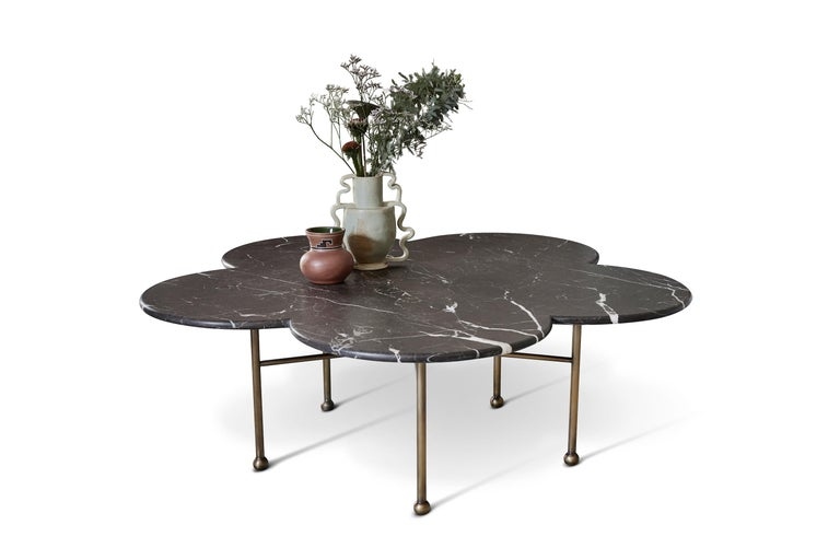 Hand-aged brass pairs with curvilinear honed marble in our archer table, shown in St. Laurent marble. This item is available a variety of additional finishes, including Carrara, Rojo Alicante, Calacatta Viola & Travertine.  Dimensions: 48