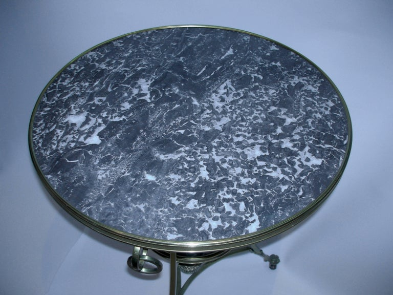 Black marble gueridon/side table on wheels.