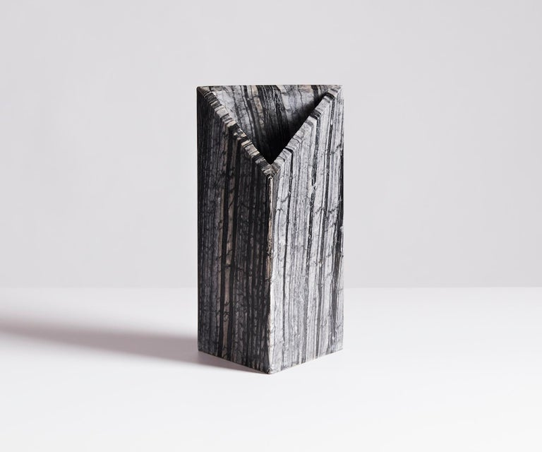 The Triad Vase was inspired by the natural patterns of Black Kenya marble. The vase balances texture and form through a subtle combination of geometry and meticulous grain matching. The vase is composed of four tiles that were carefully selected to