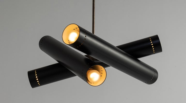 """Black metal and brass tubular chandelier, Italy 21st century.  Series of black metal tubes with perforated detailing on brass rod.  Measures: 23.75"""" diameter x 32"""" height."""