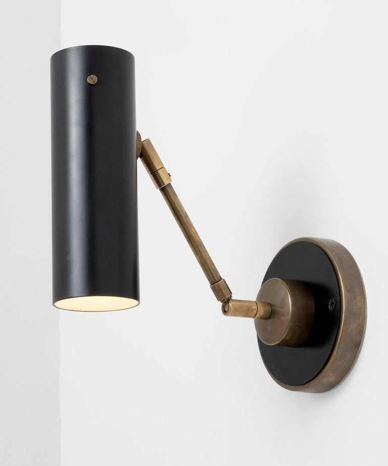 Adjustable wall lights in the style of Tito Agnoli.