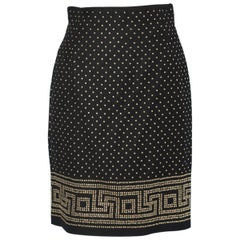 Black mini skirt with gold studs Istante of Versace
