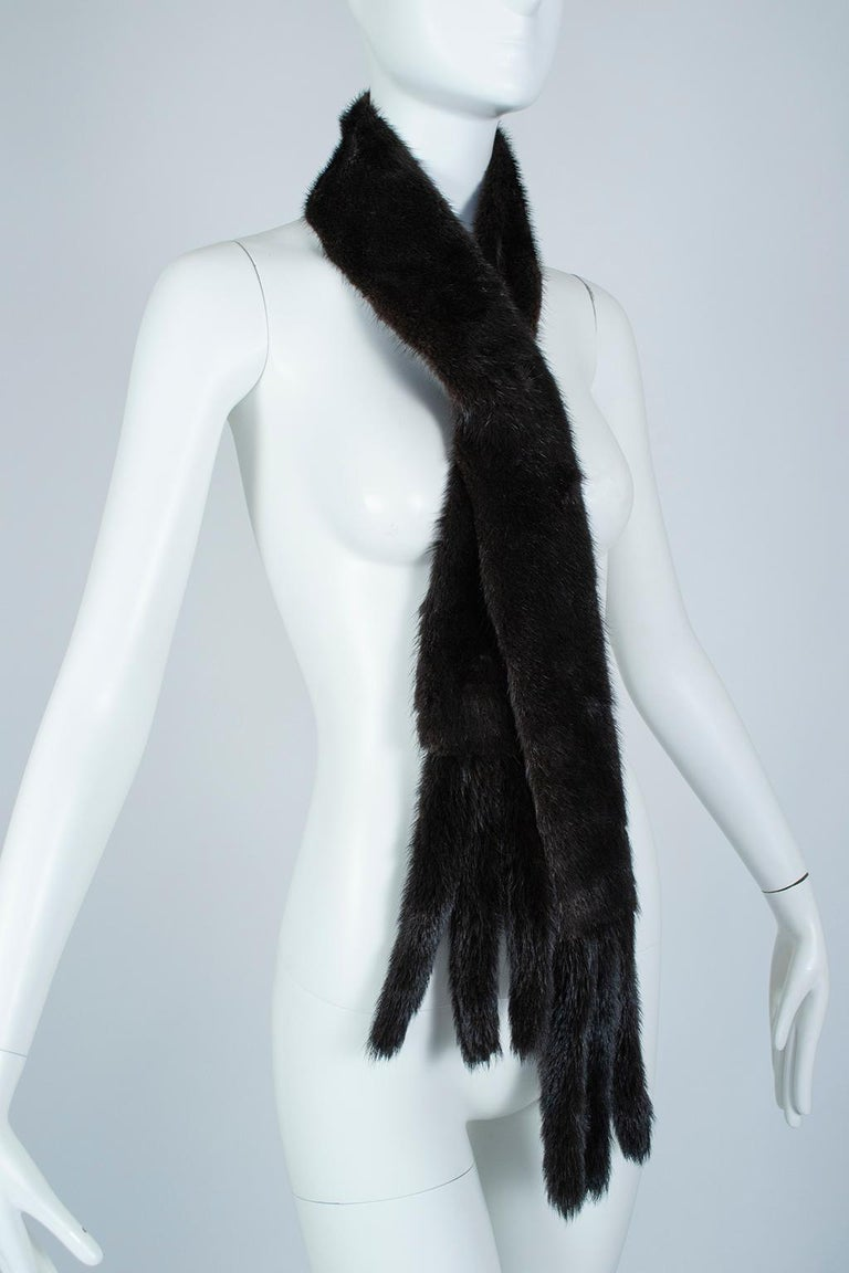 Fur shoulder cowls are as timeless as a set of pearls; supremely ladylike, tasteful and essential with strapless dresses, they will never go out of style.  The narrow design permits styling as scarf or belt, and the quilted satin lining is a subtle