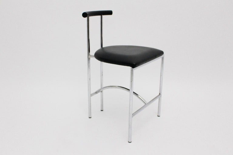 This side chair Tokyo was designed by Rodney Kinsman 1985 for OMK Design. Also the materials are chromed tube steel and the covering from the seat and the back consists of black faux leather. The vintage condition is very good with minor beloved