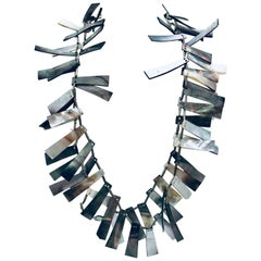 SYLVIA GOTTWALD, Black Mother of Pearl with Silver spacers Statement necklace.