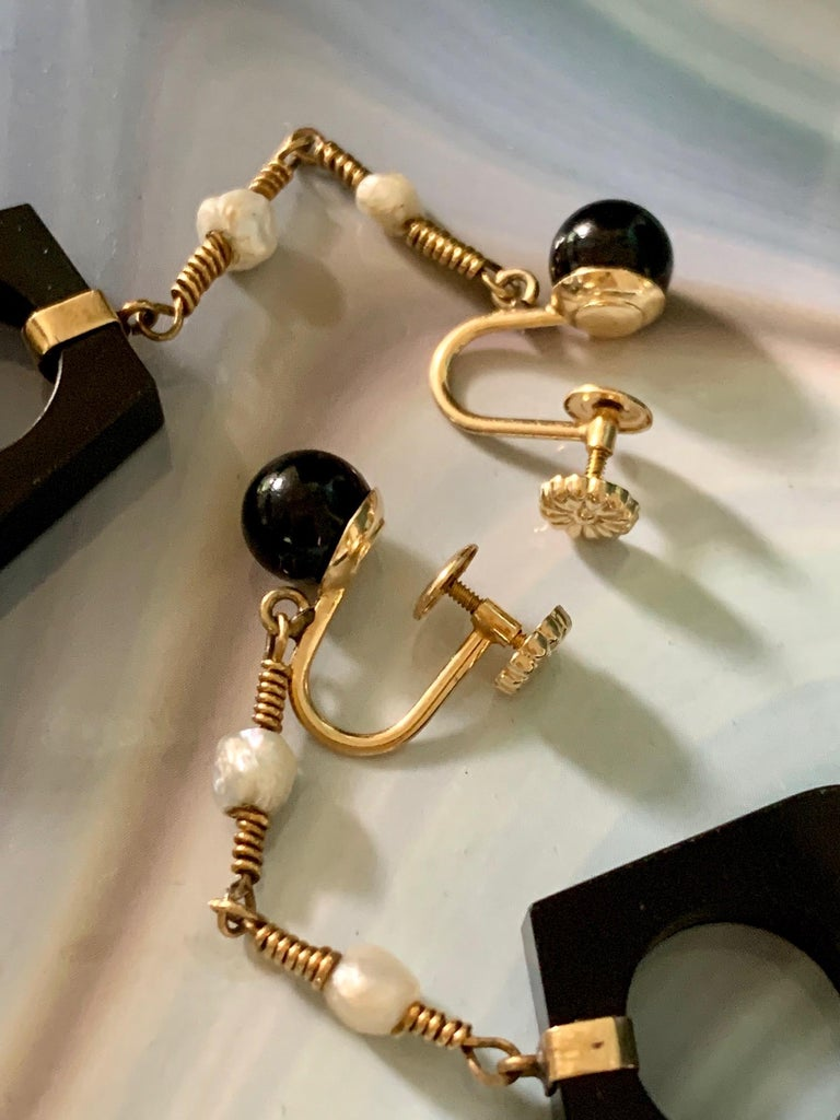 Mixed Cut Black Onyx and Fresh Water Pearl 14 Karat Yellow Gold Dangle Screw Back Earrings For Sale