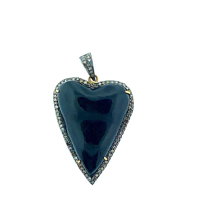 This stylish necklace is crafted of sterling silver that featuring a Champagne diamond pave setting encasing a shark tooth shaped black onyx pendant stone. Black Onyx pendant measures almost  2 inch from bail to tip of tooth and 1 1/4 inch in width.