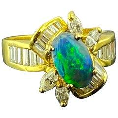 Black Opal and Diamond Ring in 18 Karat Yellow Gold