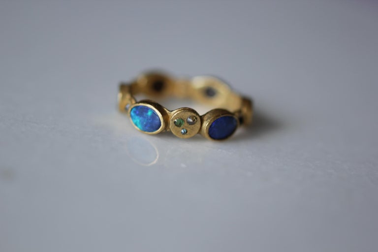 1001 Night: ring #3. 22K gold fashion band ring. Rich and exotic Black Opals are bezels set in solid 22k yellow gold and accented with color diamonds, sapphires and Tsavorite garnets creating a bright and interesting conversation piece. We love