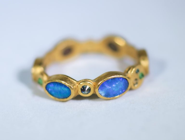 1001 Night: ring #3. 22K gold fashion band ring. Rich and exotic Black Opals are bezels set in solid 22k yellow gold and accented with color diamonds, sapphires, and Tsavorite garnets creating a bright and interesting conversation piece. We love