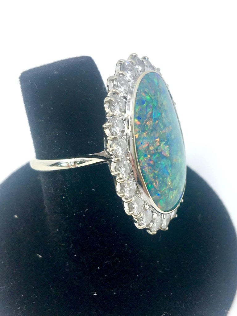 Black Opal Oval Cut 13 Carat Platinum And Diamond Ring For