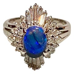Black Opal, Round Brilliant and Tapered Baguette Diamond and Platinum Ring