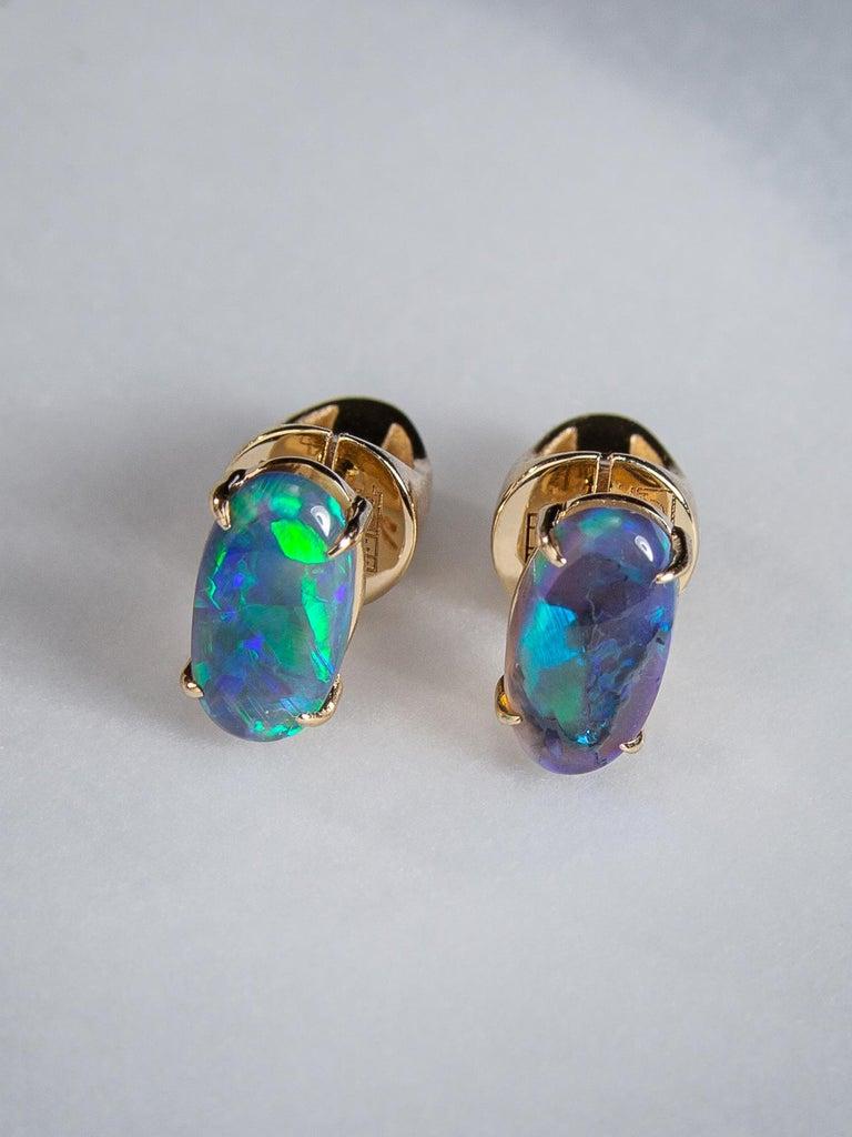 Black opal stud earrings earrings in 14k yellow gold  opal origin - Australia stone measurements 0.079 x 0.16 x 0.35 in /  2 х 4 х 9 mm earrings weight - 2.75 grams opals weight - 1.35 carats