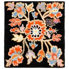 Black, Orange, and Blue Tibetan Floral Rug