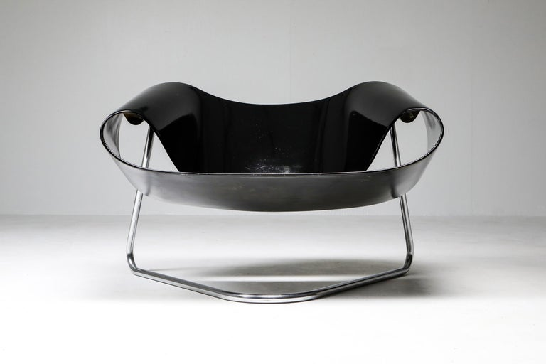Franca Stagi, CL9 ribbon chair, black, Bernini, Italy circa 1961   Moulded fibreglass seating section on chrome tubular base.   Gorgeous high-end piece by a female designer, in original condition.    The ribbon is a symbol of awareness and