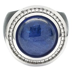 Black Ring with a Cabochon Tanzanite of 12.08 Carat and 36 H&A cut Diamonds