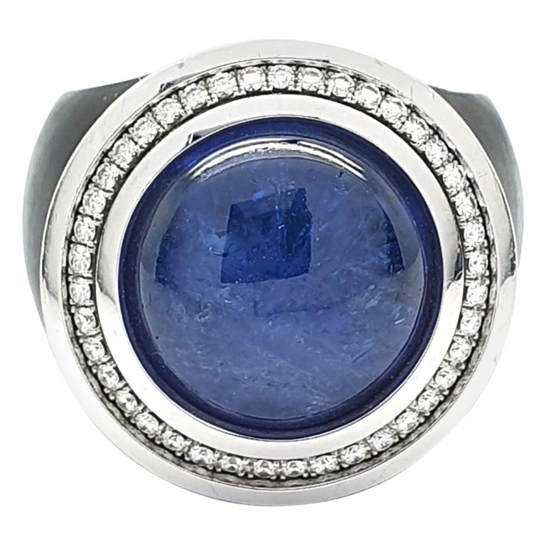 Black Ring with a Cabochon Tanzanite of 12.08 Carat and 36 H&A cut Diamonds For Sale