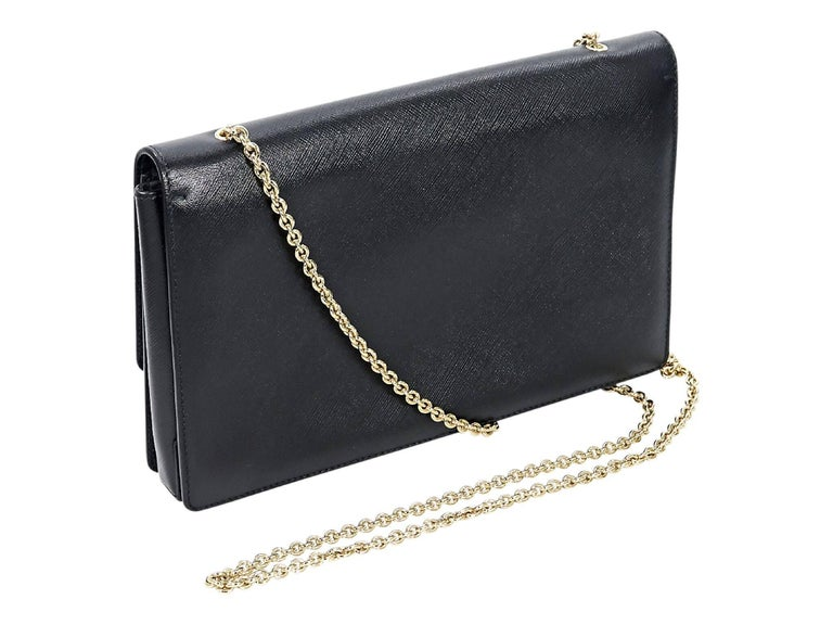 Product details:  Black saffiano leather Miss Vara crossbody bag by Salvatore Ferragamo.  Tuck-away chain crossbody strap.  Front flap with magnetic snap closure.  Lined interior with inner zip pocket.  Goldtone hardware.  Dust bag included.  10