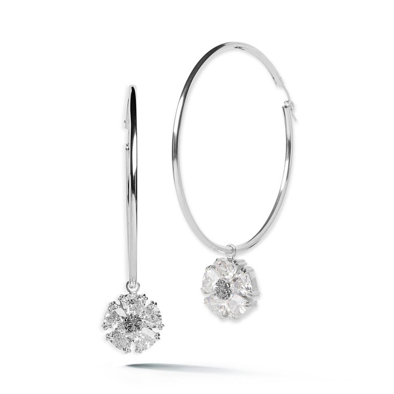Designed in NYC  .925 Sterling Silver 10 x 7 mm Black Sapphire Blossom Stone Dangle Hoops. Big dangle hoops take on an edgy elegance with beautiful blossom with stones dangling. Blossom stone dangle hoops:   Sterling silver  High-polish