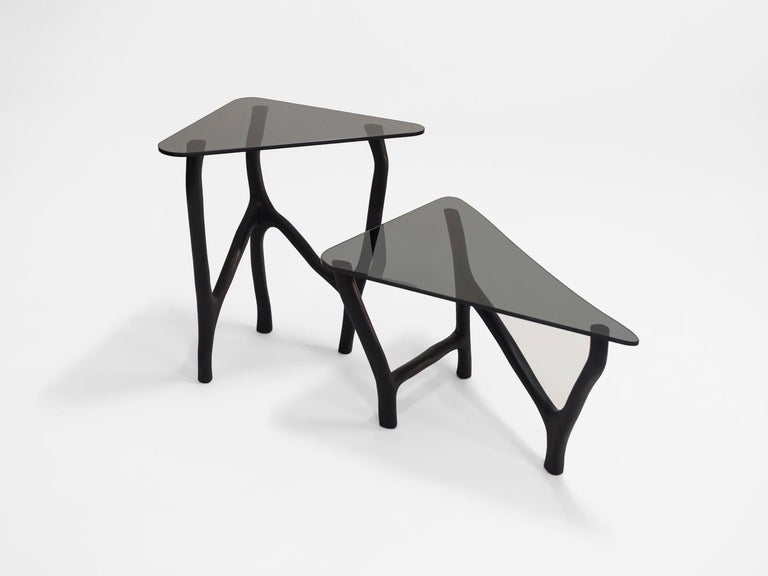 Black Side Tables by Robin Berrewaerts Materials: Ebonized oak - dark grey glass - oil finish Dimensions: W 35, D 40, H 76 (high) Dimensions: W 70, D 50, H 40 (low)  Robin Berrewaerts was born in 1991, he works and lives in Brussels, Belgium.