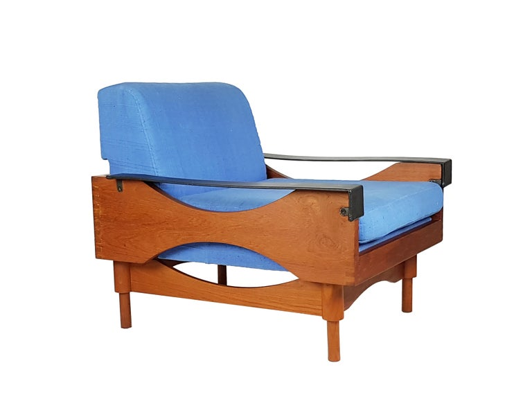 This pair of beautiful armchairs was made from teakwood structure, black skai armrests and light blue fabric covering. All cushioned parts such as the backrest, the seating, etc. are removable (see the last picture). Very good condition: the