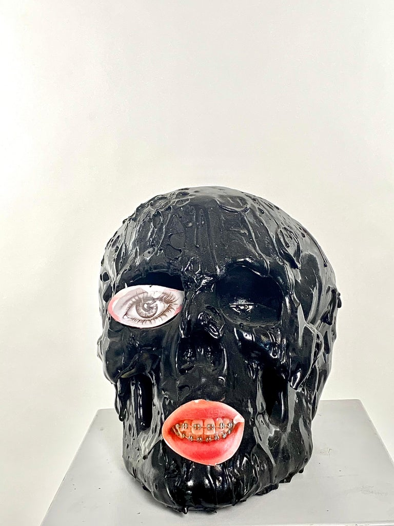 This is a new work by Mattia Biagi Sculptural Tar skull and print on aluminum eye and mouth.