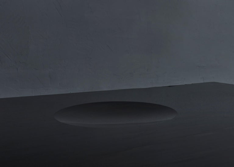 Black slate sculpted low table by Frederic Saulou