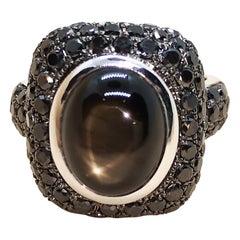 Black Star Sapphire with Black Diamond Ring Set in 18 Karat White Gold Settings