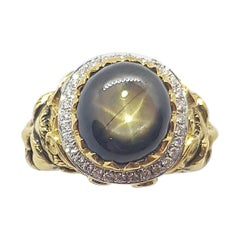 Black Star Sapphire with Diamond Ring Set in 18 Karat Gold Settings