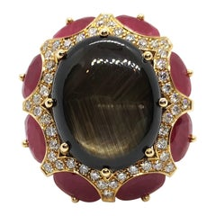 Black Star Sapphire with Ruby and Brown Diamond Ring Set in 18 Karat Rose Gold
