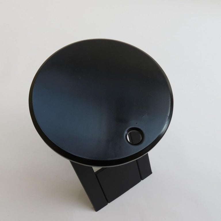 Folding Suzy stool, designed by Adrian Reed for Princes Design Works. Originally designed in 1984, this stool dates from the late 1980s. Original black finish. Folds flat when not in use.  In good vintage condition with minimal signs of