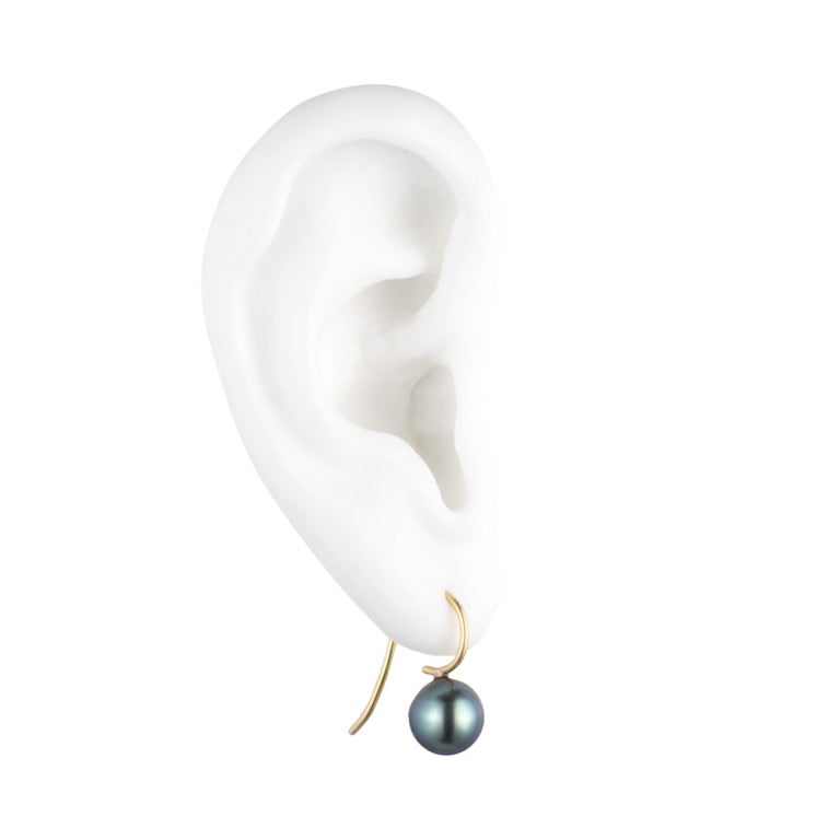 Our delicate & daintiest version of our Tahitian cultured pearl & 18K gold signature earrings. Perfect for everyday.  Description: These range in size from approximately 8.5-9.5mm and are dark grey with a green overtone.