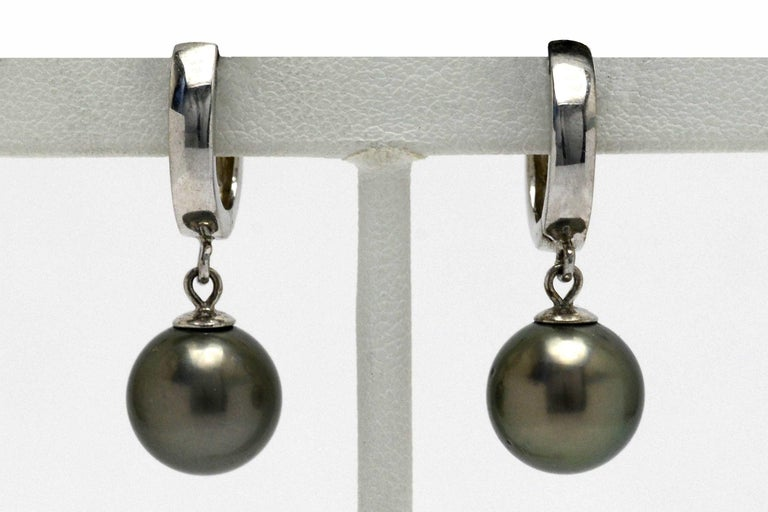 A wonderful pair of Black Tahitian Pearl Dangle Earrings in a desirable large, 10mm size. With the most mesmerizing silvery gray-black overtone and shimmering luster, these eminently wearable drop earrings sway seductively and capture the slightest