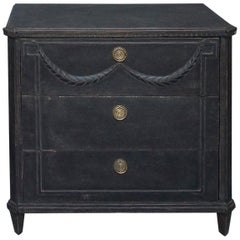Black Three-Drawer Chest with Applied Swag
