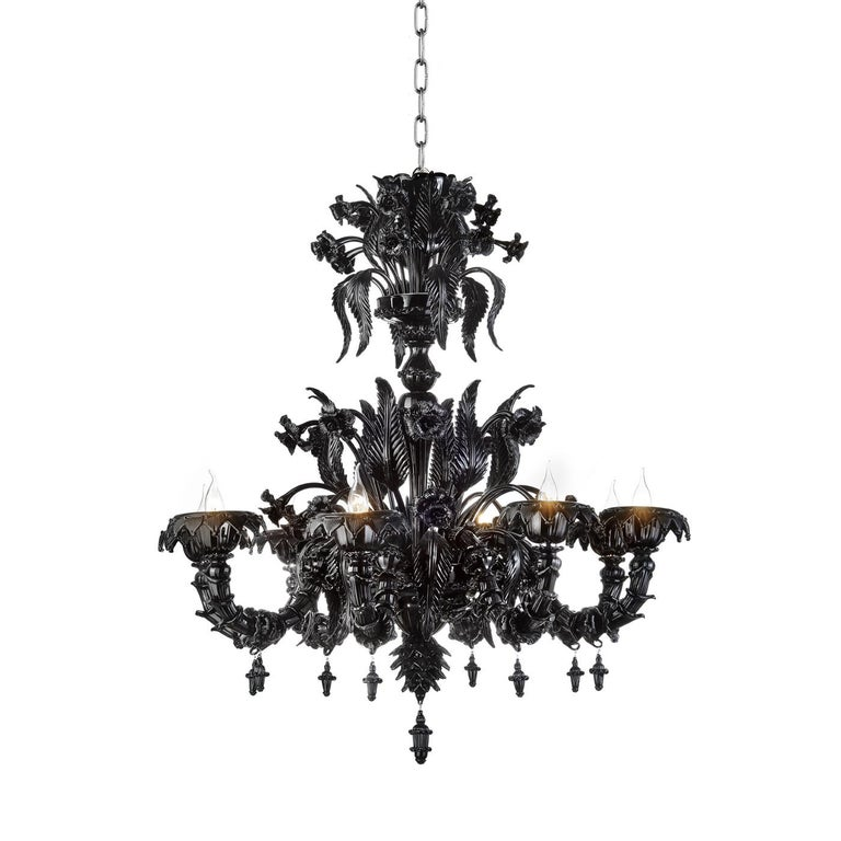 A modern take on the traditional Venetian chandelier, this exquisite piece will make a statement in any decor, creating a dramatic entrance or highlighting a dining room with elegance and drama. Pure, mouth-blown Venetian glass in black is