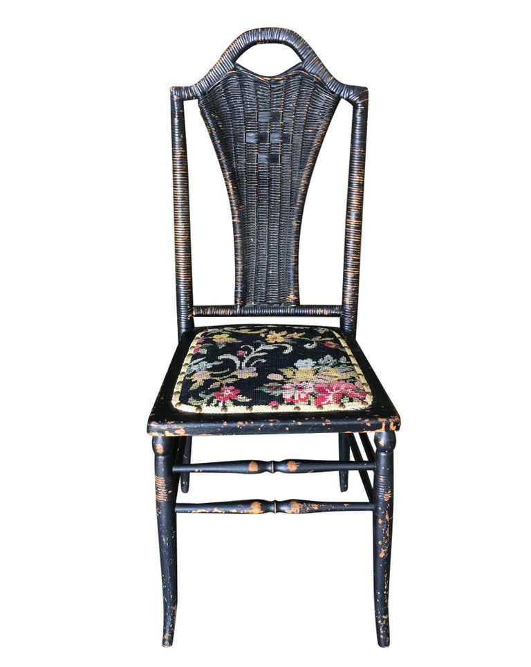 Black Victorian southern Gothic wicker back side chair with a Thonet style sculpted wood frame, needle point seat and woven wicker seat back.