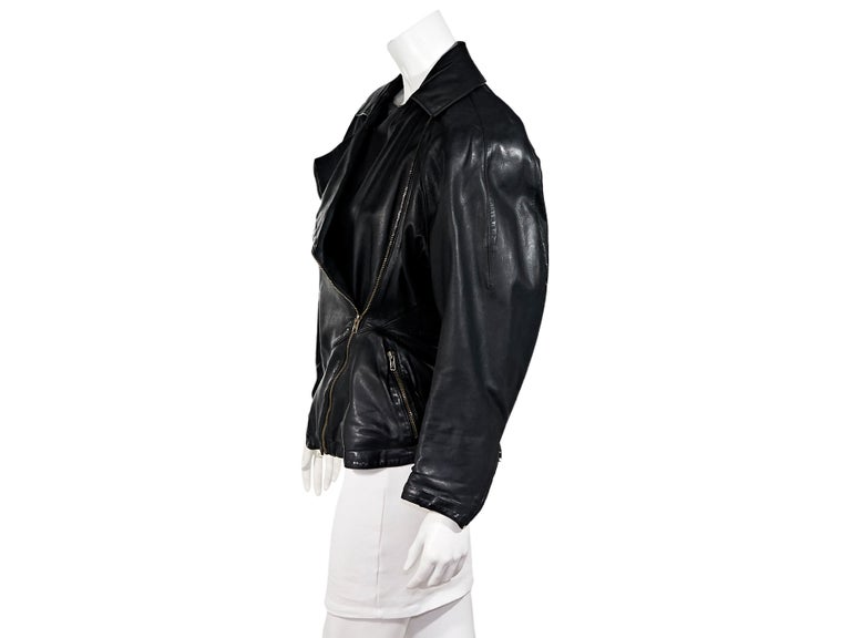 Product details:  Vintage black leather jacket by Alaia.  Circa the 1980s.  Long dolman sleeves.  Zip cuffs.  Asymmetrical zip-front closure.  Chest and waist zip-front pockets.  Goldtone hardware.  40