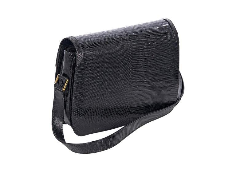 Product details:  Vintage black snakeskin shoulder bag by Gucci.  Adjustable shoulder strap.  Front flap.  Concealed clasp closure.  Leather interior with multiple inner compartments and inner zip pocket.  Goldtone hardware.  10