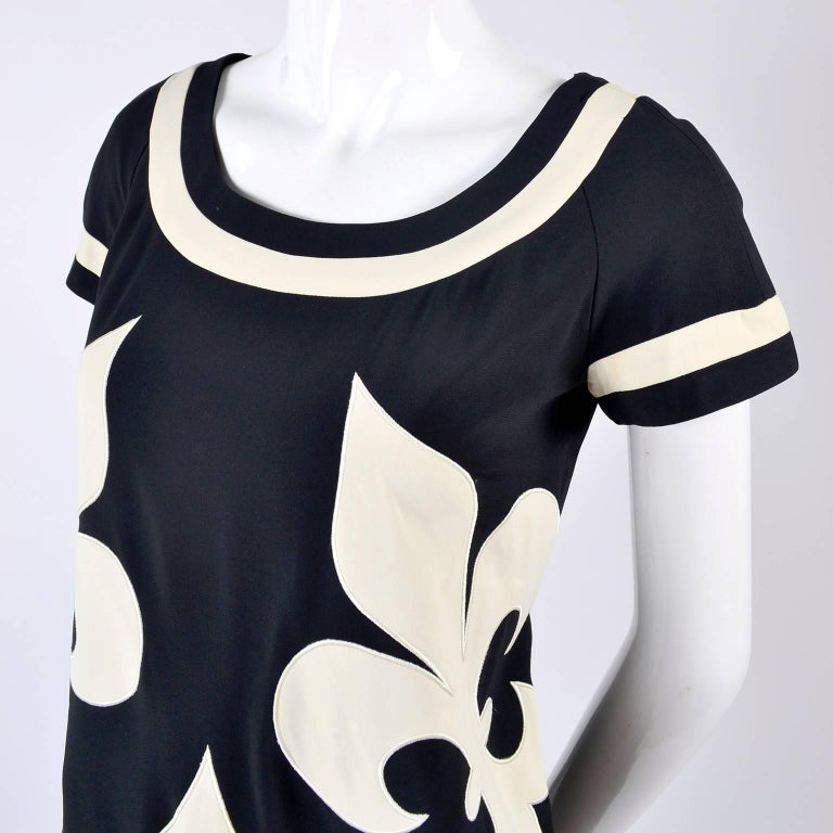 Black 1989 Vintage Moschino Couture Cruise Me Baby Dress in Bold Fleur de Lis Print For Sale