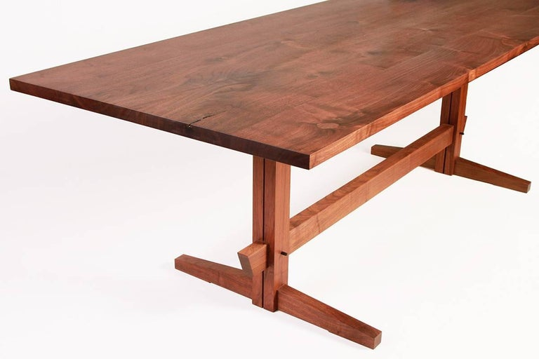 New York Heartwoods' contemporary Low-Trestle dining table is inspired by the timeless elegance of Asian and Mid-Century Modern design. Designed by Sojen Design exclusively for NYH. The table is handcrafted using traditional joinery techniques,