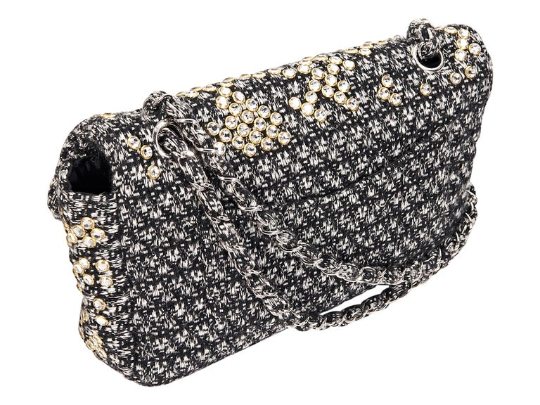 1b68a9540fba Product details: Black and white tweed classic flap shoulder bag by Chanel.  Accented with