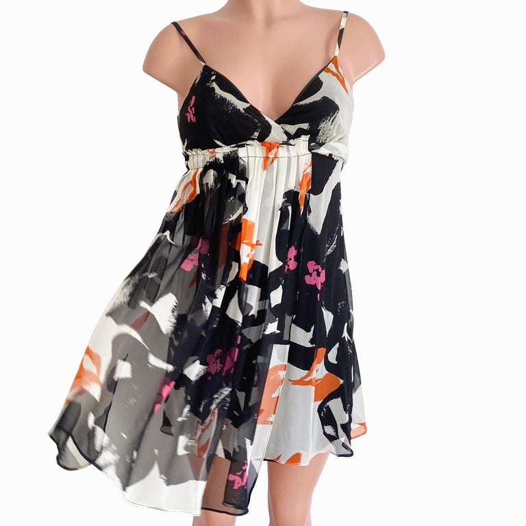 New with tag. Throw on a little cardigan or a Biker jacket over this flirty and romantic silk georgette dress from FLORA KUNG. Wear it with stiletto sandals, flip flops, or ankle booties! This versatile little dress travels and packs beautifully and