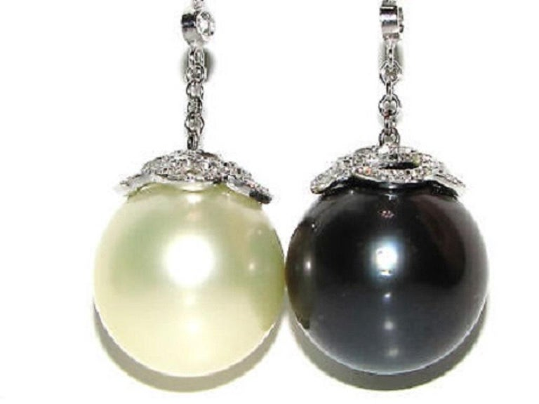 15mm Natural South Sea Pearl & Tahitian Pearl  The Black White classic Cluster Dangle  White / Cream Color  Grey / Black color  4.00ct. diamonds  G-color, Vs-2 clarity.  Measures:   3 1/4 inches long  14kt. white gold  18.1 grams  Appraisal: $13,000