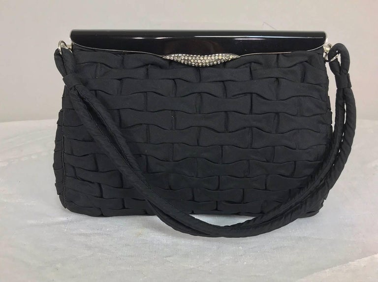 Black woven silk evening bag with enamel, rhinestone and silver frame from the 1950s...This beautiful bag is lined in black satin with two open compartments...An IPhone 7+ will fit inside...Double silk handle...In lovely condition. Measurements are