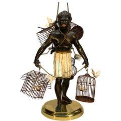 Blackamoor Sculpture of Bird Salesman with Five Birdcages